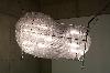 Inextricabilia : Chen Zhen, Lumière innocente, lit d'enfant, tubes en plastique, ampoules, 2000 Courtesy Galleria Continua, San Gimignano (Italie)