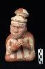 Le Pérou avant les Incas : Bouteille à anse-goulot en étrier représentant un prêtre aveugle en prière, le visage scarifié d'oiseaux, de poissons, de reptiles ainsi que d'un pénis et d'un vagin. 300-400 apr. J.-C., Moche III, céramique modelée et peinte, H. 19,7 ; l. 12 ; L. 21 cm.