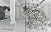 François Réau : Vue d'exposition, Pornbach, Allemagne  A gauche, To what extent. 2016, mine de plomb, graphite et incisions sur papier, 280 x 370 cm.  A Droite, Anatom of Fairy Tale. 2018, arbre et fil a plomb en suspension,  Creation in situ, dimensions variables.