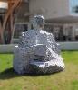 4e Biennale de sculpture. Le corps de la sculpture. : Le grand assis, Denis Monfleur, 2013, lave de Chambois, 163x140x110 cm, crédit photo : Francis Hammond
